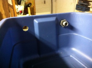 """Inside the fish tank, holes cut, one """"bulkhead"""" in place"""