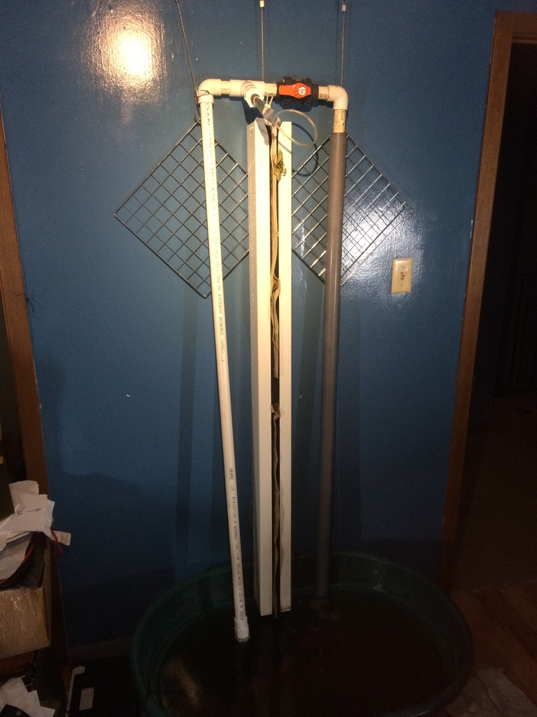 """Single 1.5M ZipGrow Tower with custom water management manifold.  Grey pipe is """"return drop"""" shroud."""