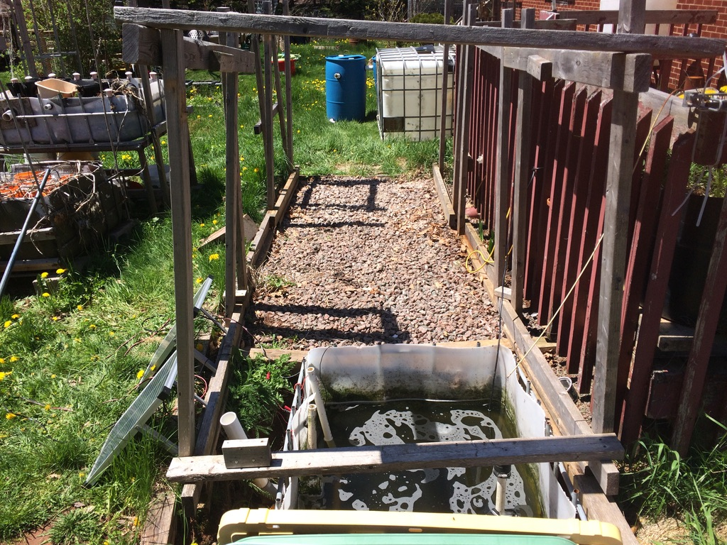 Late May, 2021.  Backyard aquaponics system Mk.III dismantled.  All that remains is the wooden frame and the sump tank.